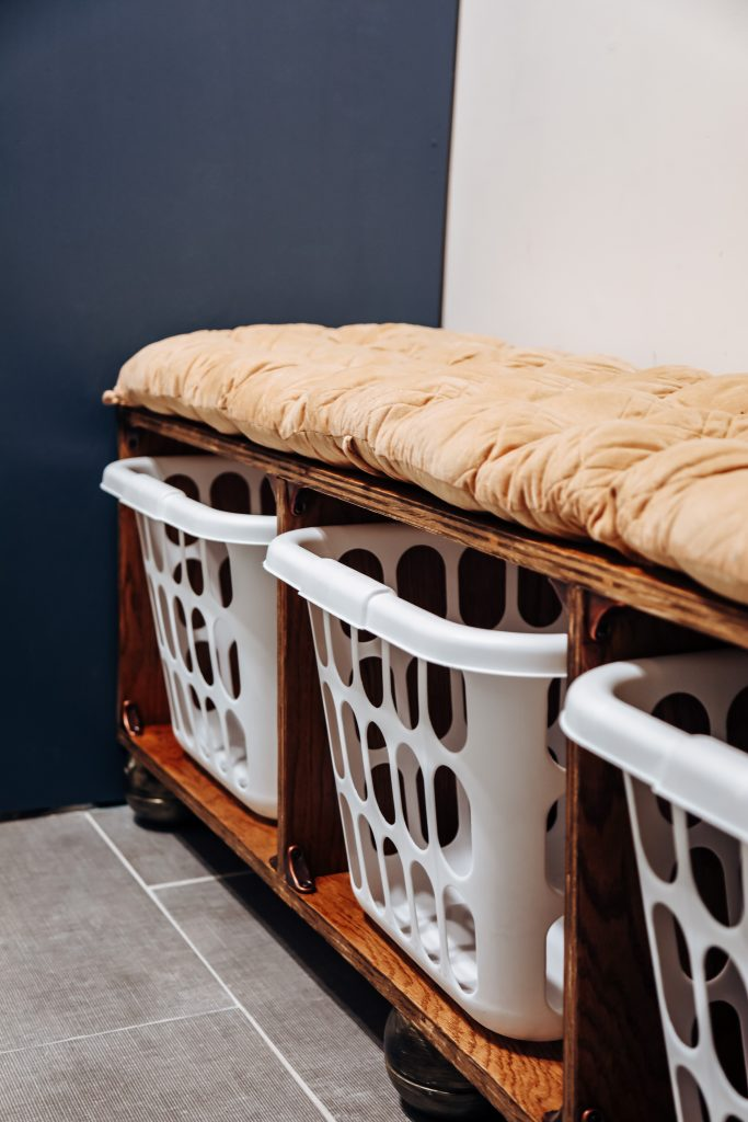 storage solutions. putting laundry baskets in a bench makes this functional and cute.